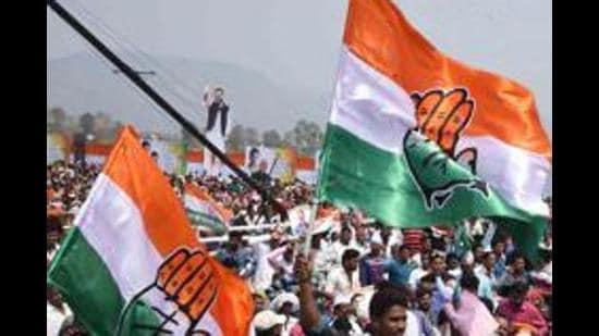 Congress supporters wave party flags. (File photo/Arabinda Mahapatra)