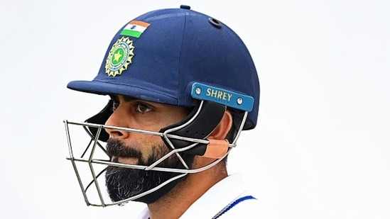 Virat Kohli looks dejected as he leaves the field after getting out. (Getty Images)