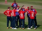 England's David Willey and Moeen Ali celebrate with teammates.(Action Images via Reuters)