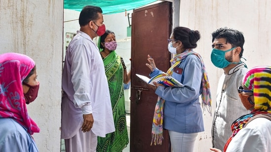 A medical team conducts door-to-door survey in Rajasthan's Bikaner to detect Covid-19 cases after a Delta Plus variant case was on Saturday.(PTI Photo)
