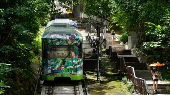 A Peak Tram passes uphill of the Victoria Peak in Hong Kong on June 16, 2021. (AP)