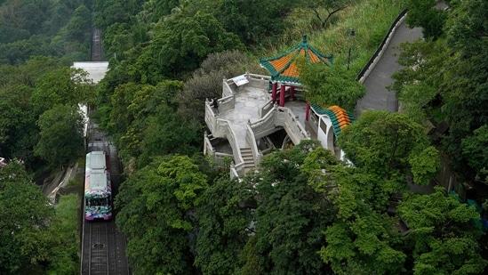 A Peak Tram passes uphill of the Victoria Peak in Hong Kong on June 17, 2021. (AP)
