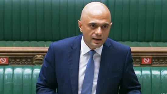"""""""No date we choose comes with zero risk for Covid— we know we cannot simply eliminate it, we have to learn to live with it,"""" Britain's new health secretary Sajid Javid said.(AFP)"""