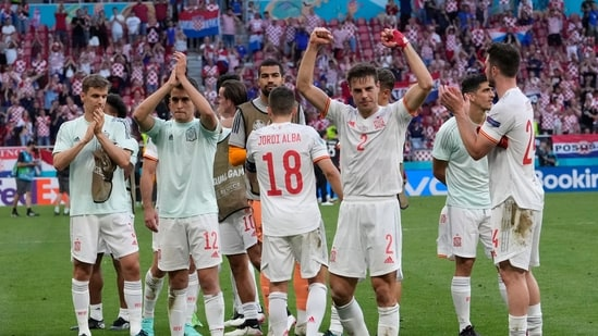 Spain players celebrate with fans after winning their Euro 2020 round of 16 clash against Croatia in Copenhagen.