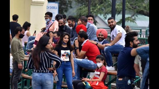 Tourists spotted without masks at the Ridge in Shimla. The number of visitors has gone up since the Covid curbs were eased on June 14. (Deepak Sansta/HT)