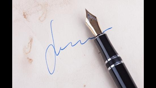 Putting pen to paper. (Shutterstock)