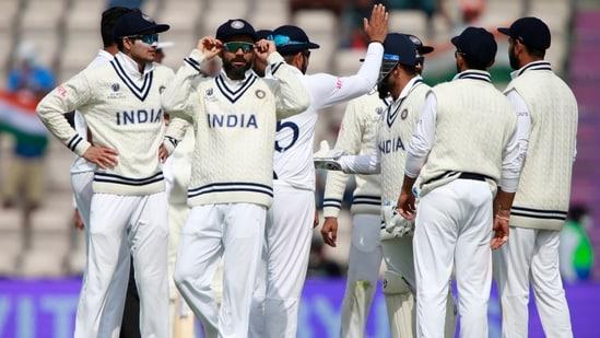 India's captain Virat Kohli, second left, and teammates celebrate(AP)