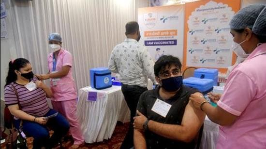 Beneficiaries receive a dose of Covid-19 vaccine during a camp at Vile Parle East, in Mumbai earlier this month. (File photo)