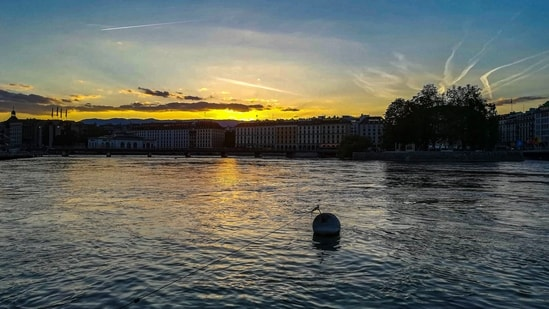 """Geneva: Headquarters of the International Committee of the Red Cross and European headquarters of the United Nations, Geneva is a """"green"""" city, with 20% of its territory devoted to parks.  While there, you can visit the iconic Jet d'Eau, a huge fountain seen from the shores of Lake Geneva. (Unsplash)"""