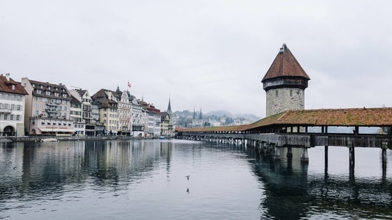 Lucerne: From city life to lakes and mountains, this place has it all.  It is most famous for its 14th-century Chapel Bridge and Water Tower and for the Dying Lion monument which was carved into the rock to honor Swiss mercenaries.  (Unsplash)