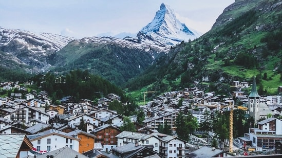 Zermatt: It is a small town famous for skiing and mountaineering.  Gasoline vehicles are not allowed in the area.  Vehicles within city limits are battery operated.  (Unsplash)