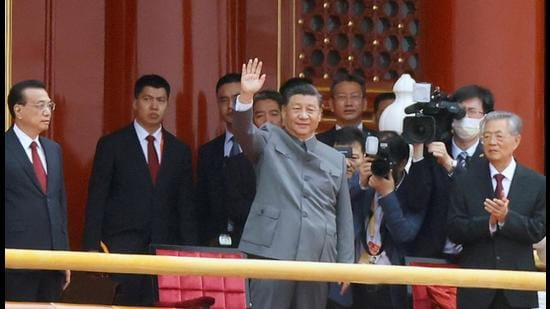 President Xi Jinping waves next to Premier Li Keqiang (left) and former president Hu Jintao at the end of the event marking the 100th founding anniversary of the Communist Party of China, on Tiananmen Square in Beijing, on Thursday. (REUTERS)