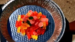 The image shows gummy bears kept in a bowl.