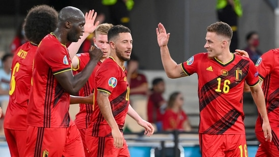 Belgium's Thorgan Hazard, right, celebrates with teammates after scoring his team's first goal during the Euro 2020 soccer championship round of 16 match.(AP)