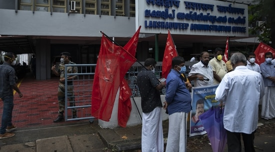 A security person checks on a visitor, left as activists of Centre of Indian Trade Unions (CITU) gather for a protest outside the Lakshadweep administration office in Kochi(AP)