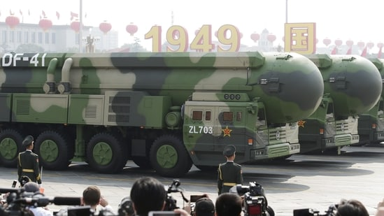 Military vehicles carrying DF-41 intercontinental ballistic missiles travel past Tiananmen Square in Beijing in October 2019. (File Photo / REUTERS)