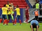 David Ospina of Colombia celebrates with teammates winning a penalty shootout. (Getty Images)