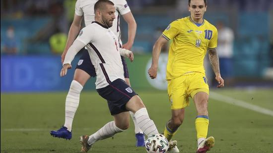 England's Luke Shaw, left, fights for the ball with Ukraine's Mykola Shaparenko during the Euro 2020 soccer championship quarterfinal soccer match between Ukraine and England at the Olympic stadium, in Rome, Italy, Saturday, July 3, 2021. (Lars Baron/Pool Photo via AP) (AP)