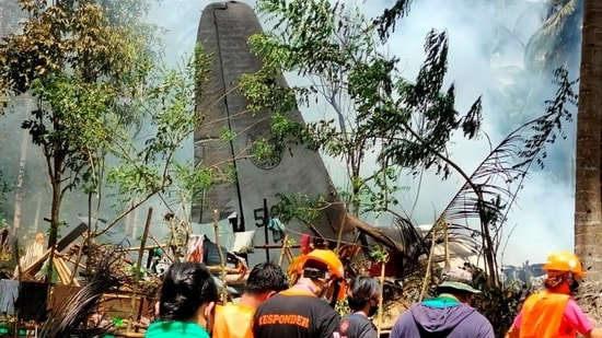 First responders work at the site after a Philippines Air Force Lockheed C-130 plane carrying troops crashed on landing in Patikul, Sulu province, Philippines.(Reuters)