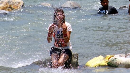 A tourist cools off in Beas river, Manali, Kullu Distict, Himachal Pradesh. ((Photo by Aqil Khan /Hindustan Times))