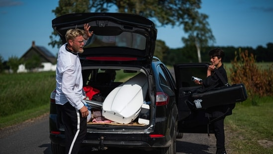 Cellist Jacob Shaw (L) and violinist Roberta Verna load their instruments in a car ahead of their classical music concert for a herd of cows on June 15 in Stevns, Denmark. The British musician, who is also a professor at the Marshall Academy in Barcelona, has set up a cello school in the rural countryside in Stevns, an hour south of Copenhagen, performing throughout the region.(Jonathan Nackstrand / AFP)