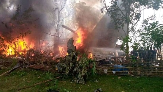 The military aircraft was seen on fire after it crashed in Patikul, Sulu, on Sunday. Initial reports said that at least 40 passengers have been rescued.(Photo via Pondohan TV / Facebook)