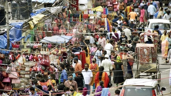 A rush of people out at Khetan Market, in Patna, Bihar, India on Saturday, July 3, 2021. (Photo by Santosh Kumar/Hindustan Times)
