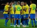 Brazil's teammates celebrate their team's 1-0 victory over Peru during Copa America semifinal(AP)