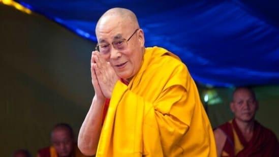 Tibetan spiritual leader the Dalai Lama greets devotees in Dharmsala.(AP)