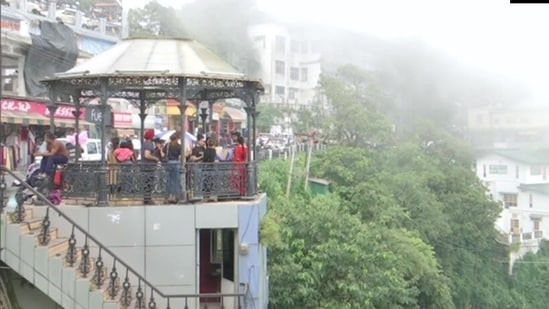 Despite the limitation of carrying a negative RT-PCR report for entering the state, tourists are flooding Mussoorie and Nainital, the popular hill stations of Uttarakhand.(ANI)