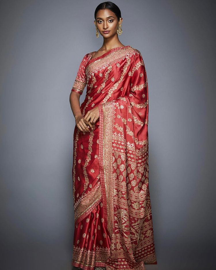 Timeless red sari with intricate aari embroidery, inspired by the heritage motifs