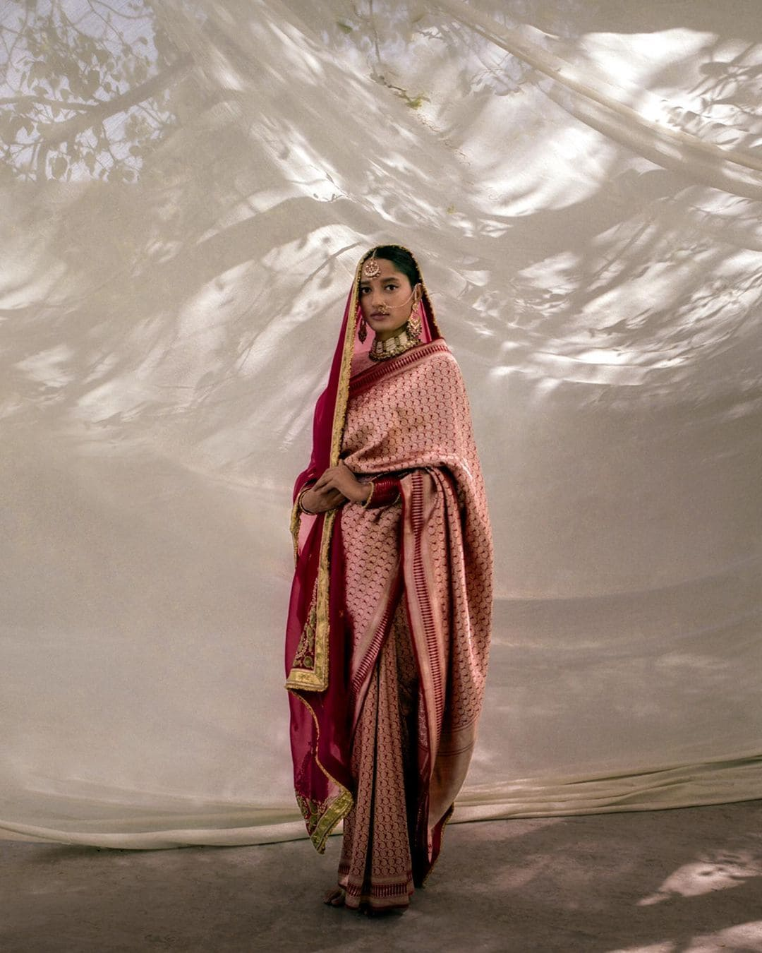 Model wearing a Varanasi silk brocade 'Amvi' sari with all-over jaal (lattice) of paisley motifs.