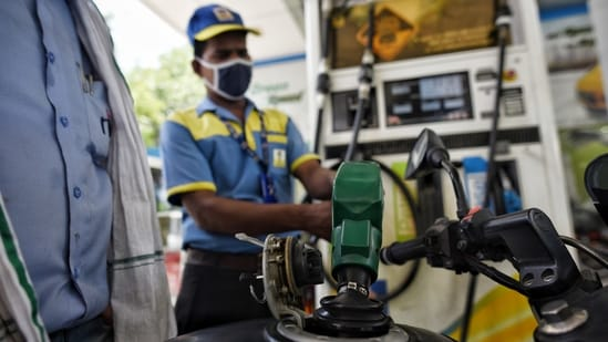 A worker refuels a motorbike at Janpath in New Delhi, India, on Wednesday, July 07, 2021. Petrol price per litre reached <span class='webrupee'>₹</span>100.25 today. (Photo by Sanchit Khanna/ Hindustan Times)