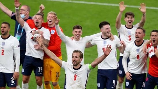 England's Harry Kane, center, and his teammates celebrate.(AP)