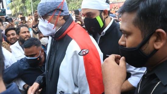 Amitabh Bachchan and Abhishek Bachchan at Dilip Kumar's funeral.