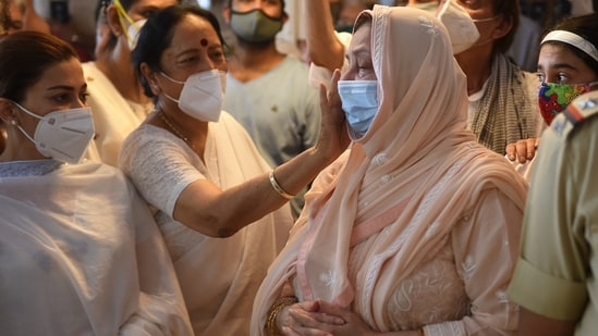 Saira Banu consoled by friends at the funeral of her husband Dilip Kumar.