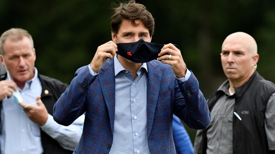 Justin Trudeau previously said authorities are looking closely at domestic Covid-19 vaccination rates.(Reuters)
