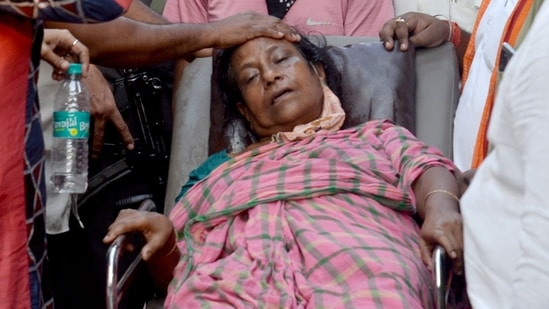 Mother of a BJP worker being stretchered off for medical assistance following the death of her son seen in this file photo fro,m May 2021. A NHRC team is currently investigation allegations of post-poll violence in Bengal. (ANI)