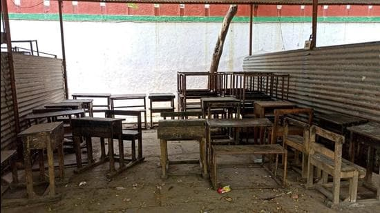"""""""Holding classes under tin roofs is not an easy task. Be it the excruciating heat of summers or incessant monsoon downpour, there are multiple challenges that students face."""" says the school in-charge. (Sadia Akhtar/HT Photo)"""