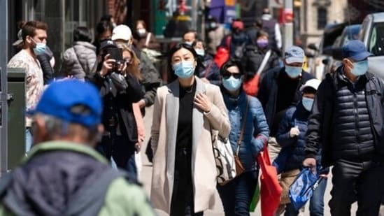 People walk the streets of New York, in the United States, as concerns peak over the spread of the delta variant of the coronavirus disease (Covid-19) in the country. (File Photo)