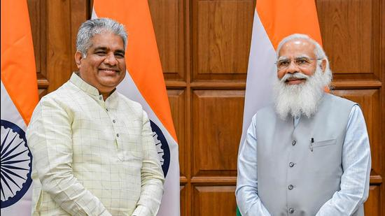 Bhupender Yadav with Prime Minister Narendra Modi before taking oath on Wednesday, July 7. (PTI)