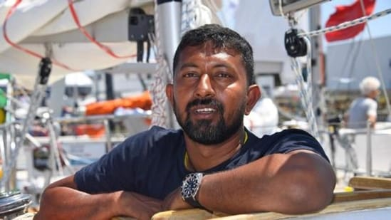 Abhilash Tomy poses on his boat Thuriya ahead of the solo around-the-world sailing race for the Golden Globe Race in 2018. (File photo)