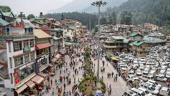 Tourists visit the Mall Road in Himachal Pradesh's Manali after relaxation in Covid-19 curfew, on July 3.(PTI Photo)