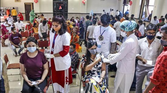 Health workers administer Covid-19 vaccine to beneficiaries during a special drive, in Beawar, Rajasthan, on Thursday, July 8. (PTI)