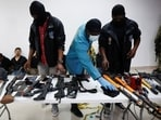 Weaponry, mobile phones, passports and other items along with suspects in the assassination of President Jovenel Moise.(Reuters)