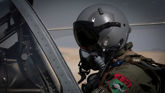 An Afghan A-29 pilot prepared for flight in the cockpit of his aircraft, at Kandahar Airfield, Afghanistan.(via Reuters / File)