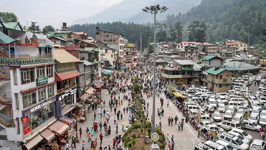 Tourists visit the Mall Road afoter relaxation in Covid-19 curfew, in Manali, Saturday, July 3, 2021. (PTI)