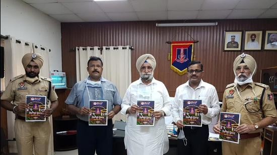 Punjab jails minister with the first copy of a magazine that inmates at the Patiala Central Jail have produced. (HT Photo)