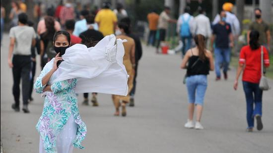 A woman's dupatta wafts in the wind at Sukhna Lake in Chandigarh. (Ravi Kumar/HT)