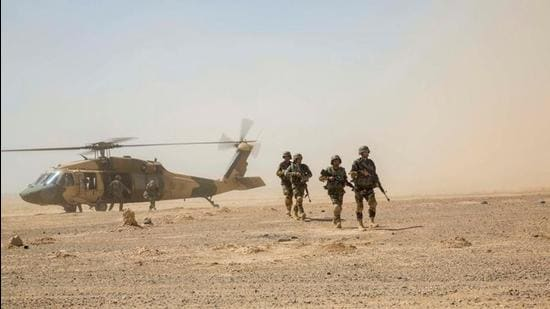 Afghan National Army 215th Corps troops disembark an Afghan Air Force (AAF) Black Hawk helicopter during a troop re-supply at Camp Shorabak in Helmand Province in 2018. (Representational image/REUTERS)